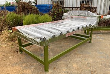 Geelong machinery exported one container:board roller conveyor machine, plywood pneumatic alignment device and square tube for building shed structure to Indone